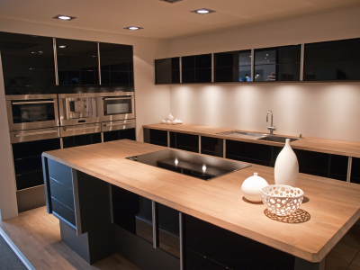 Modern trendy design black wooden kitchen wired by a residential electrician